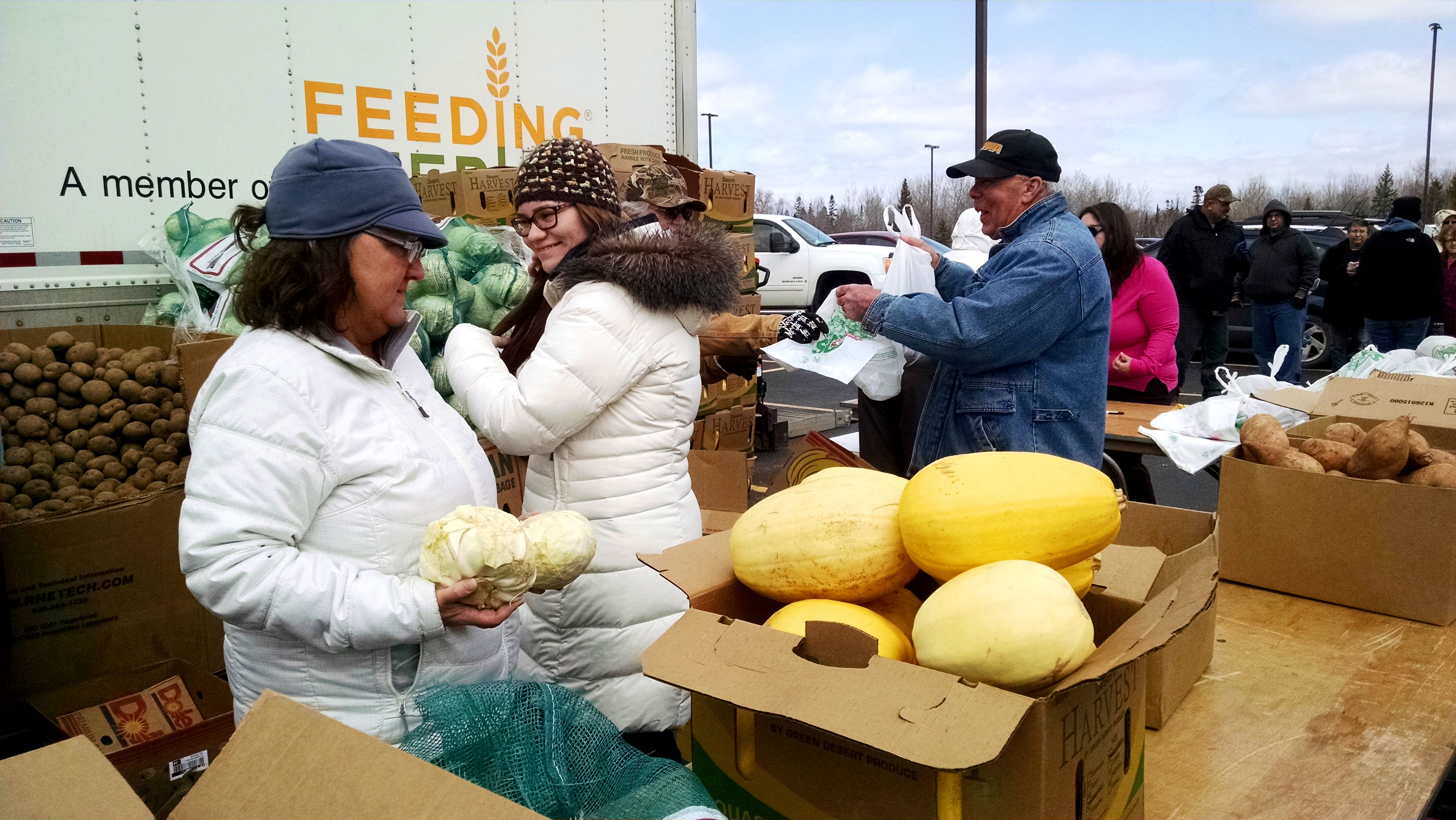 Sharon Hovie and Emily Higbee of the Sault Tribe Elder Meal Program unload food at an April 12 distribution.