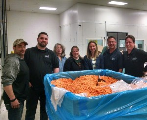 Staff from Feeding America West Michigan and the Food Bank of Eastern Michigan pictured with first Arbre Farms donation, April 21.
