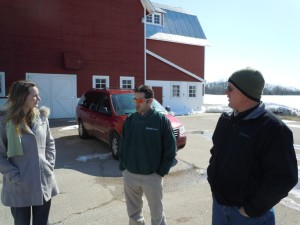 Dr. Adam Kantrovich, center, talks with Food Bank staff member Katie Auwers and fellow WMAEC board member Matt Hehl at the farm in March.