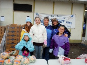 Mary Archambeau (back right) with volunteers at Link's Mobile Food Pantry in November 2013.