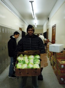 Clarence, a high school junior, varsity football player, and JROTC cadet, volunteers at Central High School's Mobile Pantry.