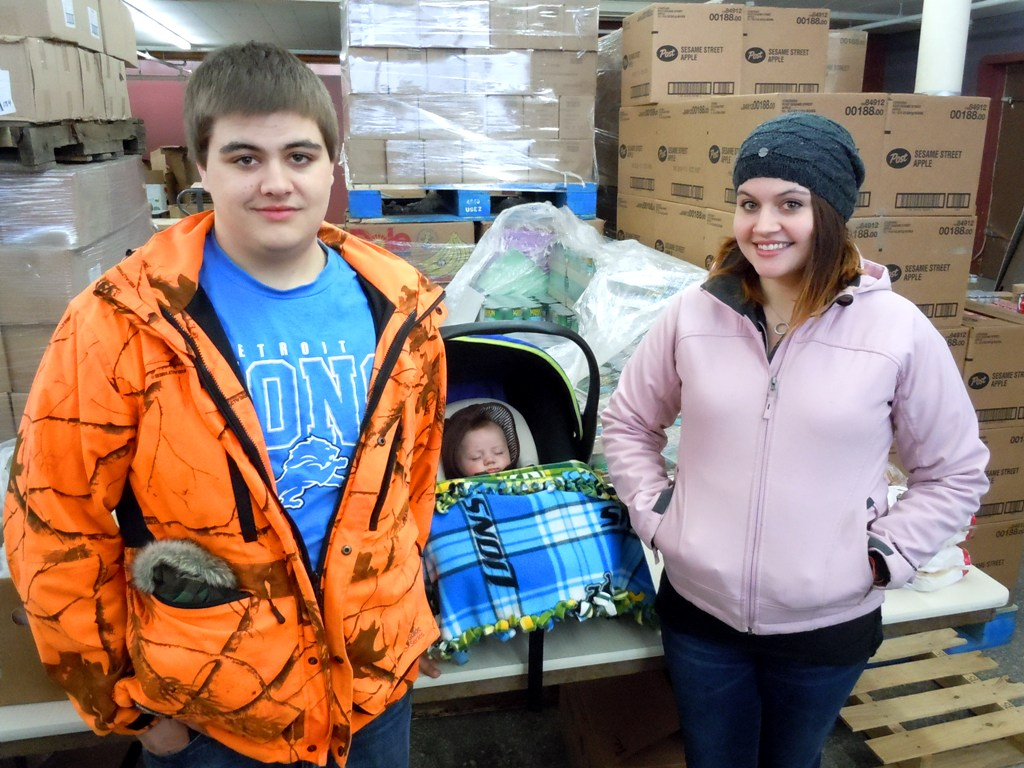 Siblings Cole and Brittany visited the Food Bank with the newest member of their family, Tanner.