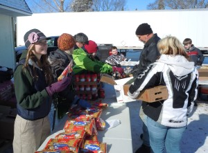 Volunteers distribute food at The Link during one of Feeding America West Michigan's Mobile Food Pantries this April.