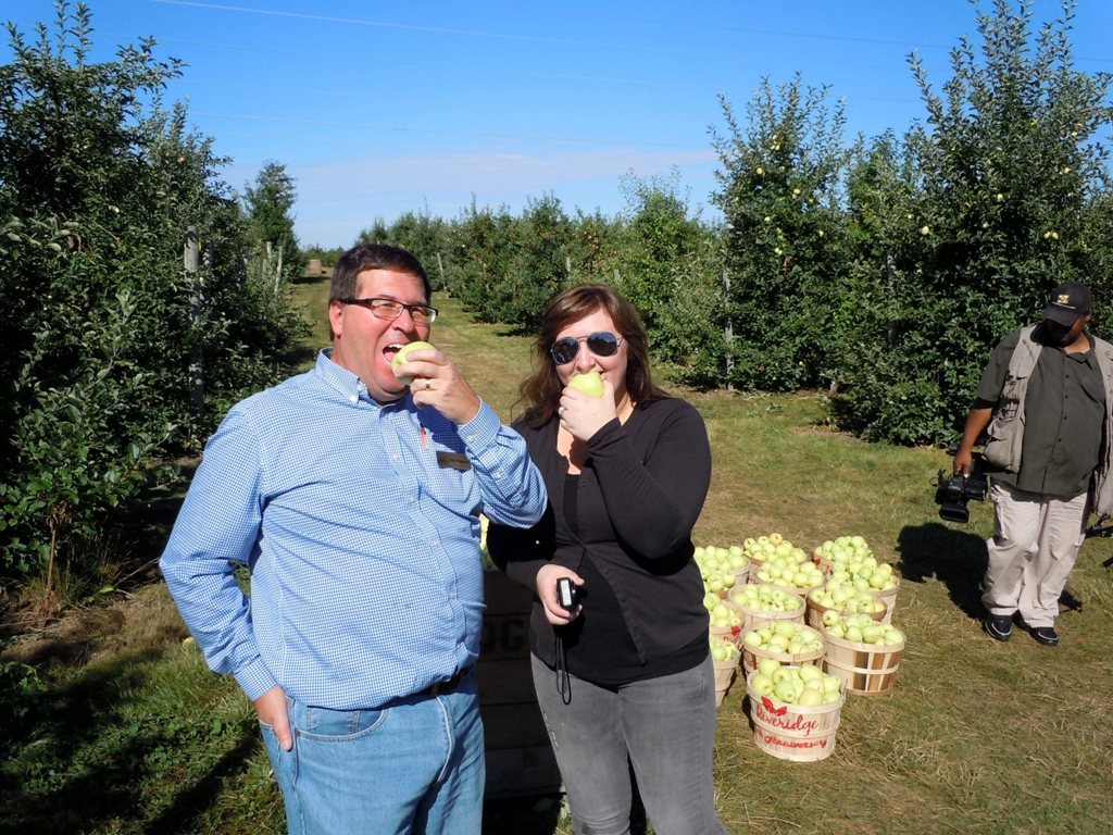 The Food Bank's Mark Christianson and Melissa Dubridge of Riveridge Produce Marketing sample some Ginger Golds.
