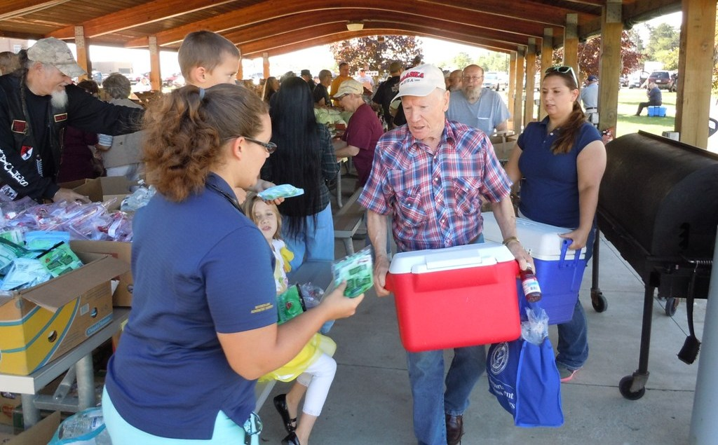 Marine Corps veteran Ed Kippenham receives food and dental supplies at the Sept. 3 distribution in Iron Mountain.