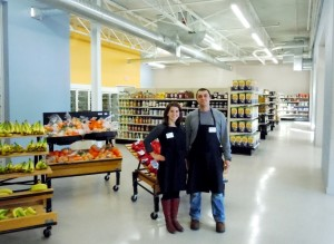 Food Club programs manager Holly Anderson stands with Ryan Van Maldegen of Feeding America West Michigan in the Food Club's location at 1100 South Division Ave in Grand Rapids.