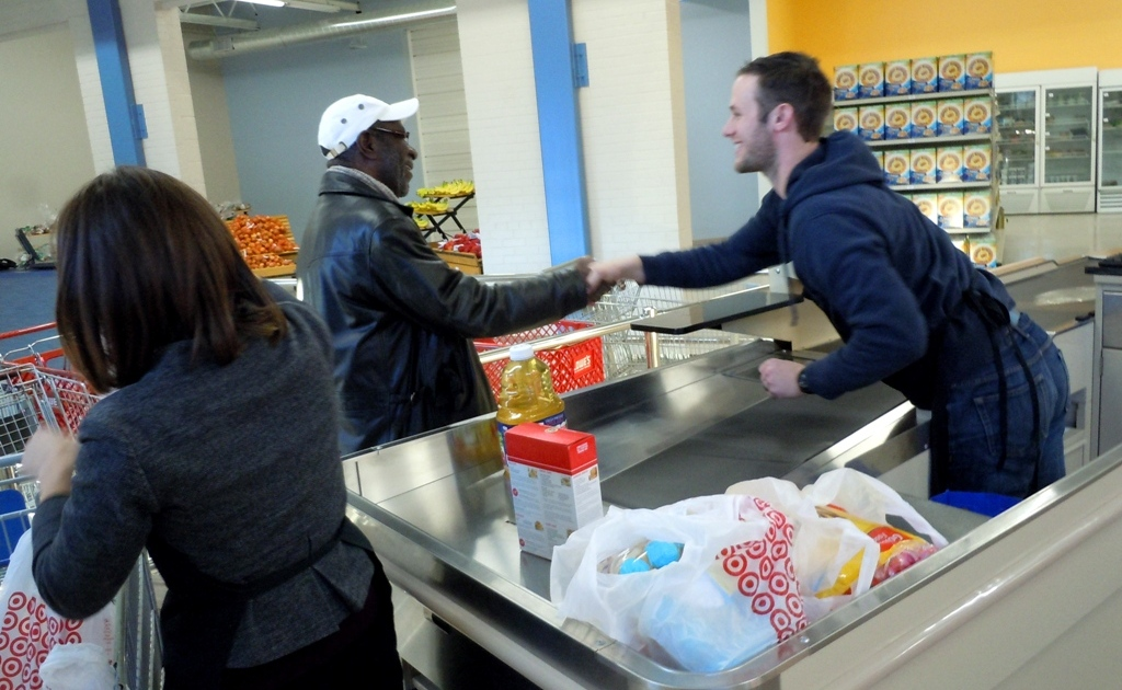 "Food Club member Robert checks out on opening day, Tuesday, Jan. 27. Compared to a traditional food pantry, he said, ""this is what I would call definitely an upgrade."""