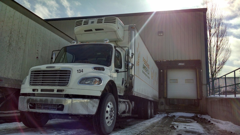 A Food Bank truck delivers food at Feeding America West Michigan's Comstock Park headquarters.