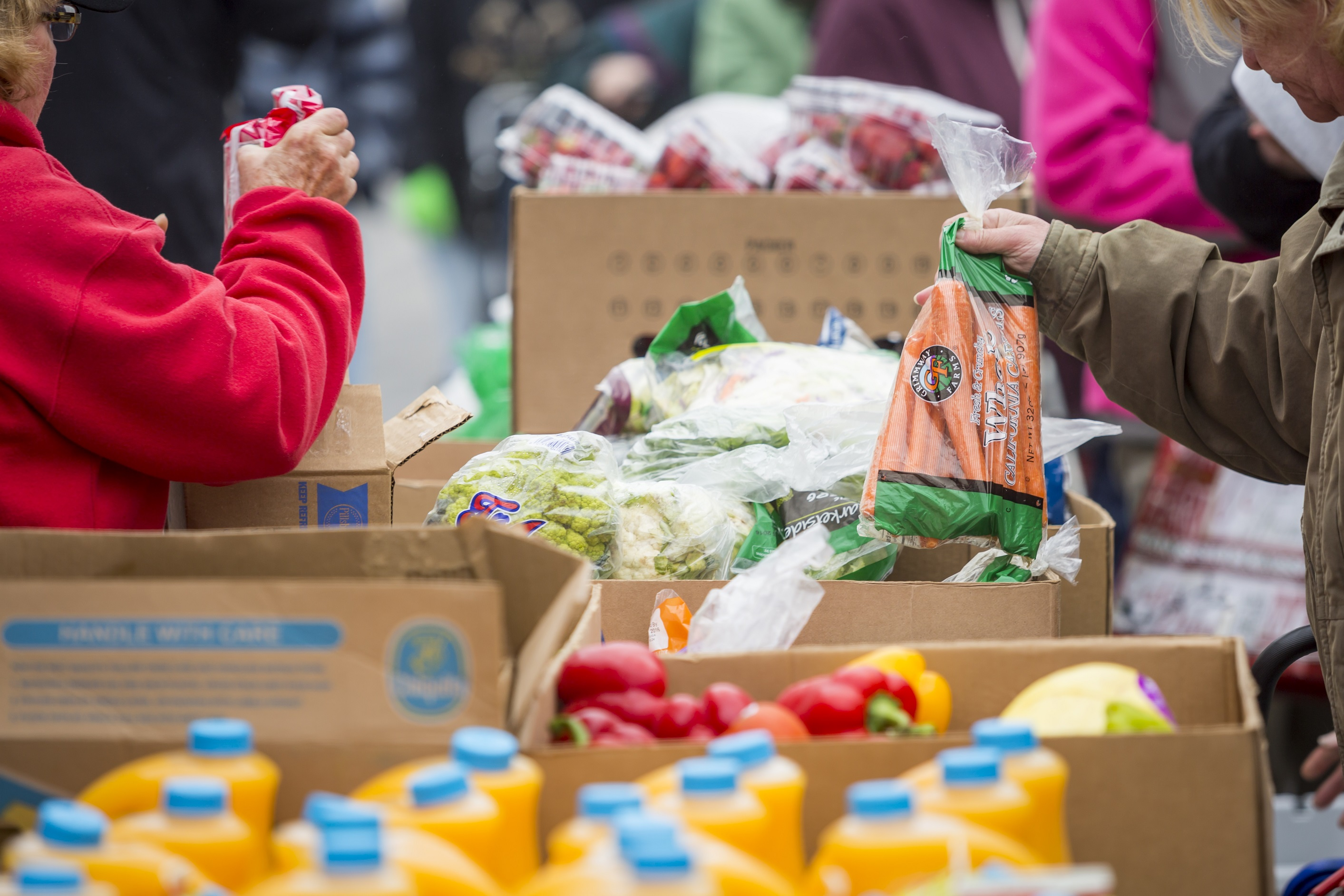 Clients receive food at a Mobile Pantry in April 2016. Credit: Feeding America West Michigan