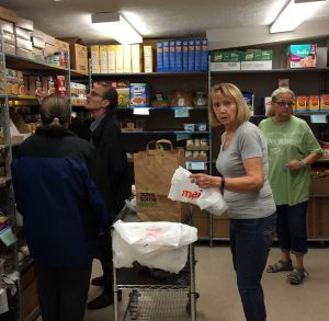 Clients and volunteers work together to combat hunger at Northwest Food Pantry. /Ellie Walburg