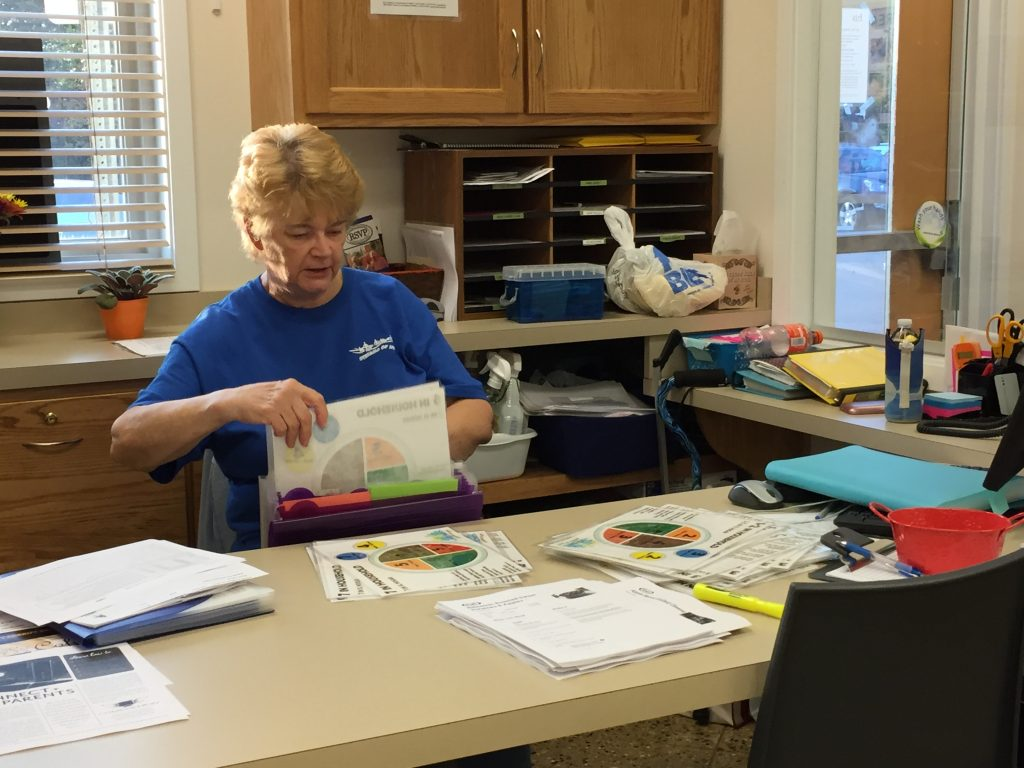 Volunteer Judy loves volunteering and helping clients at the food center.