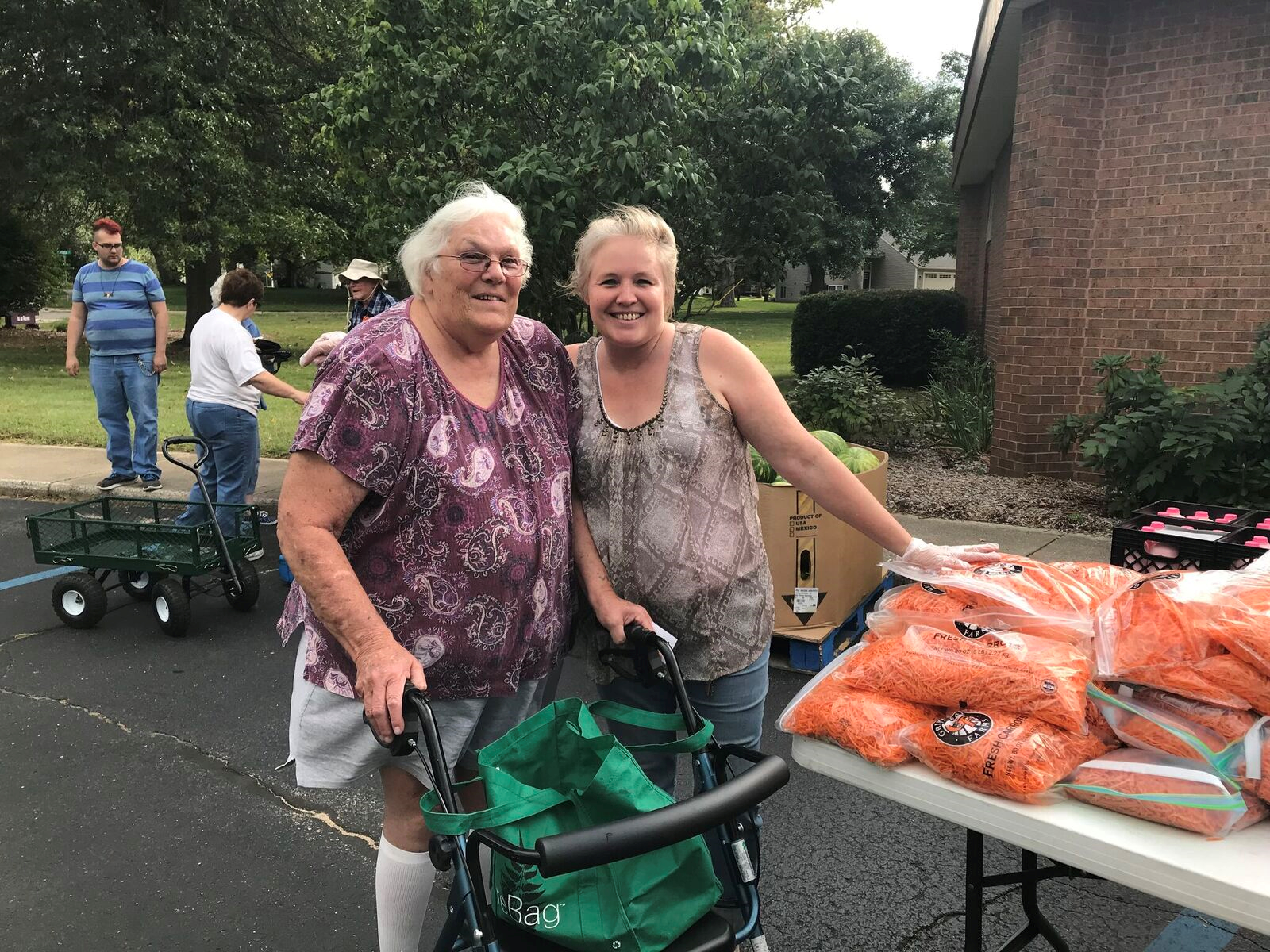 Nelda and her daughter smiling at a mobile food pantry