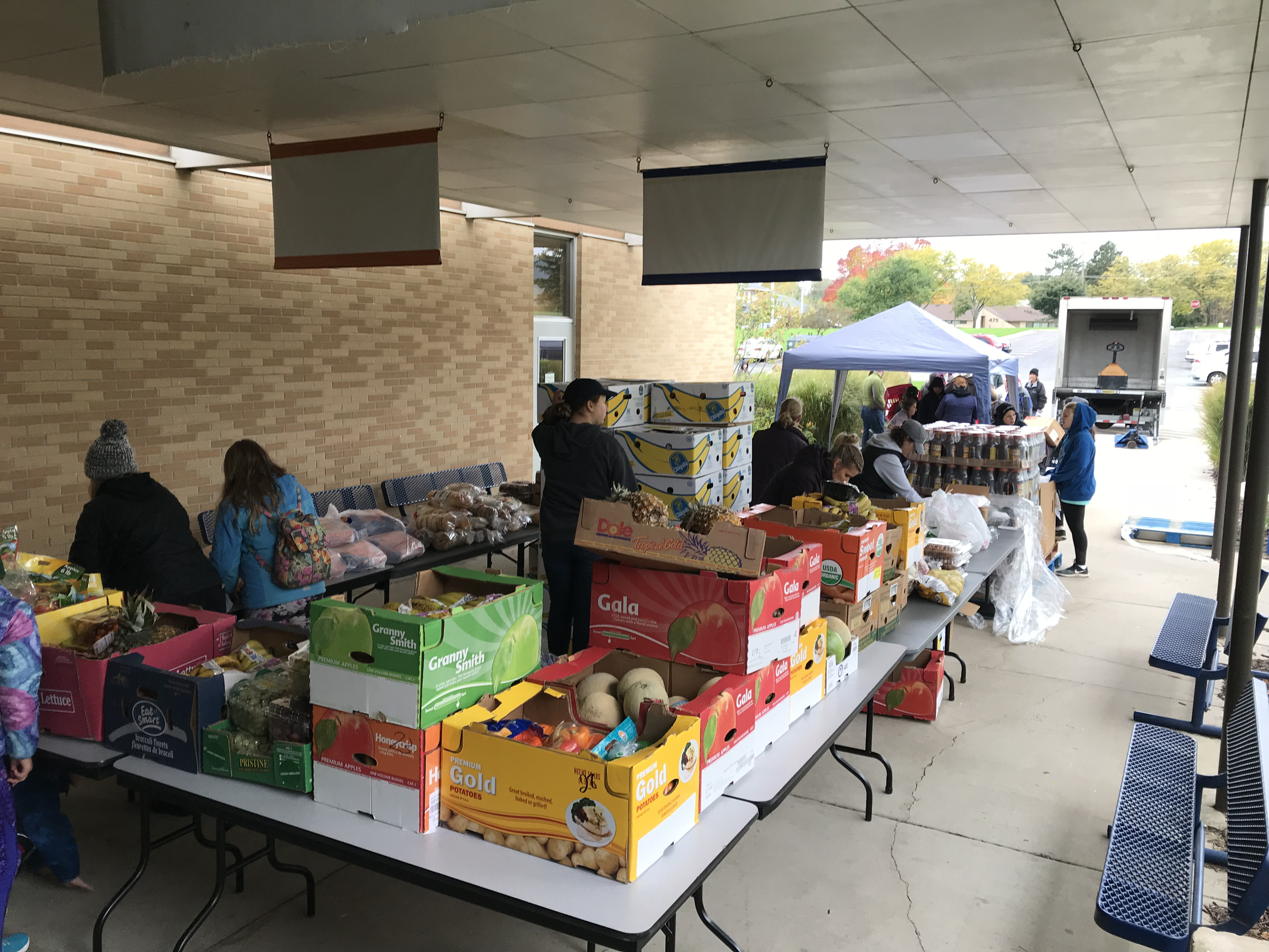 tables of food at a mobile food pantry