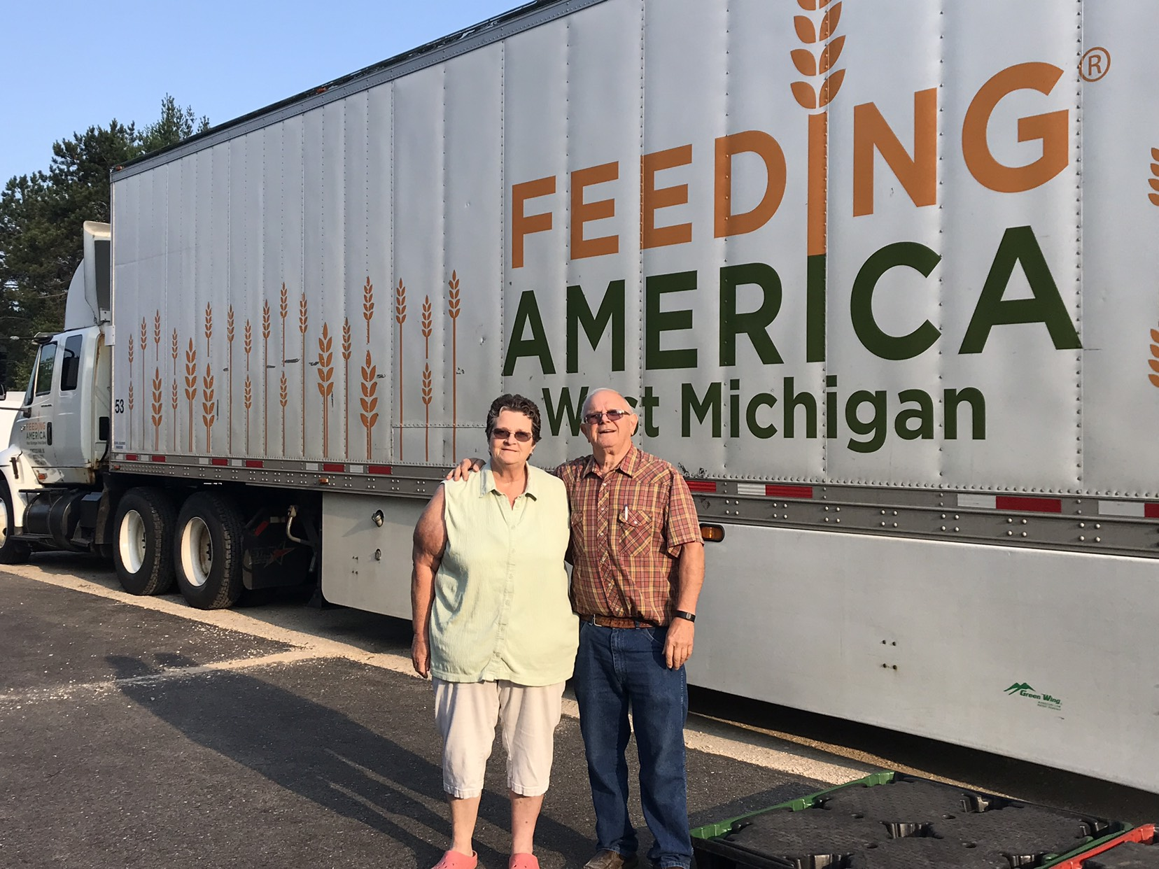 Margo and Loney in front of Feeding America West Michigan truck
