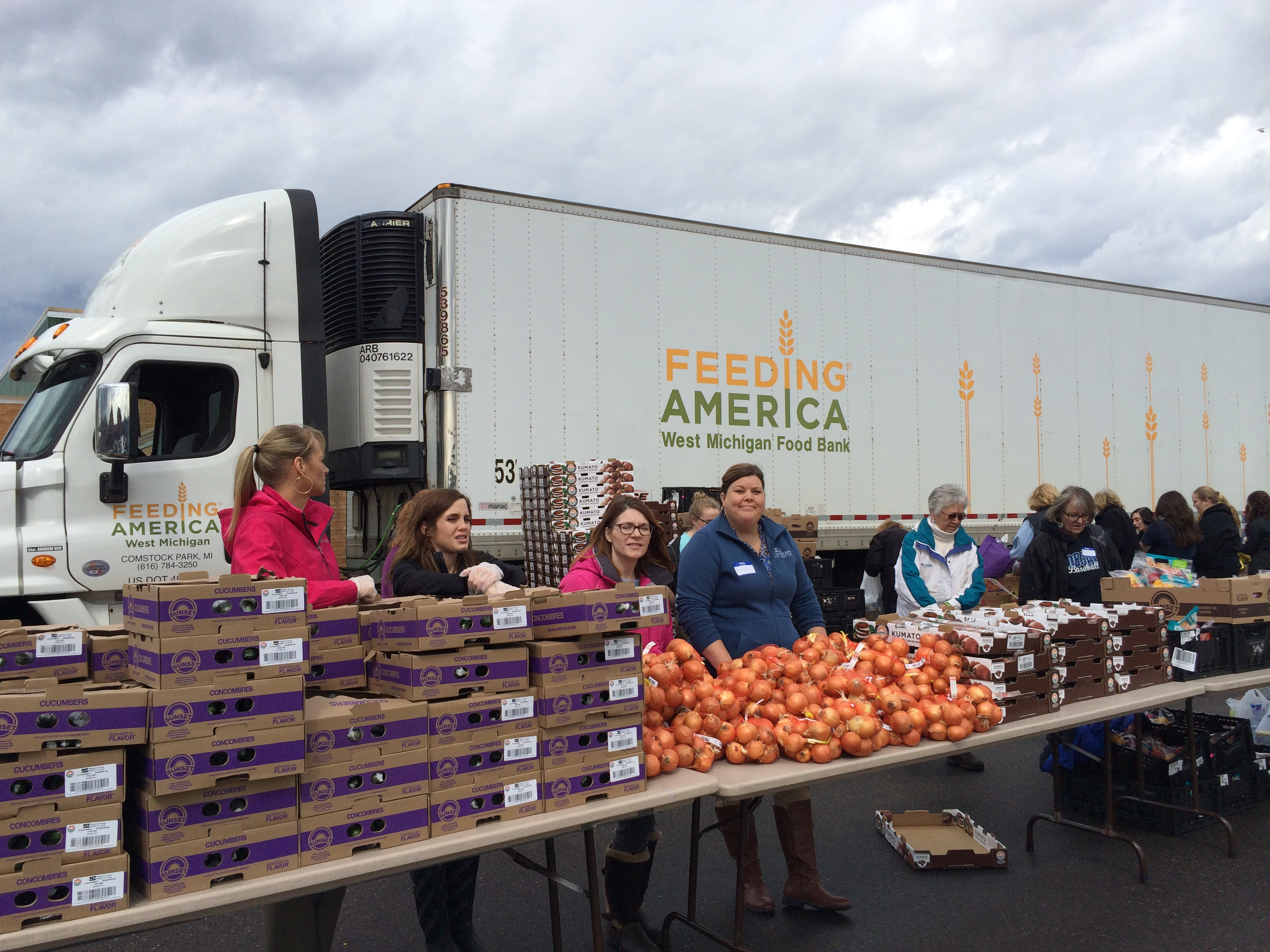 Mobile Food Pantry volunteers in front of truck with food
