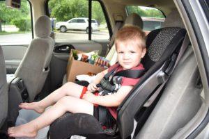 hayden in car with food behind him