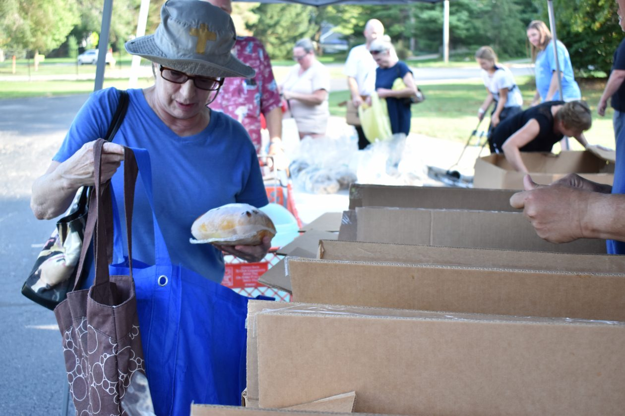 Cathy receives meat from a Mobile Food Pantry.