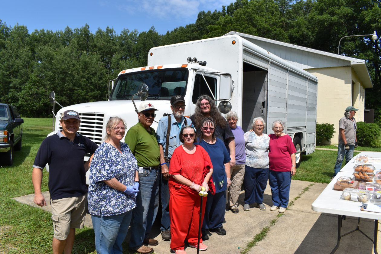 A group of volunteers poses after the food distribution.
