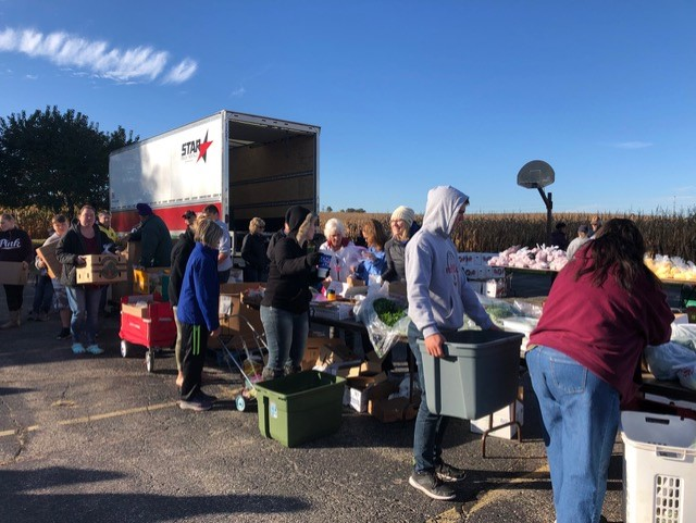 Clients wait in line at the Mobile Food Pantry.