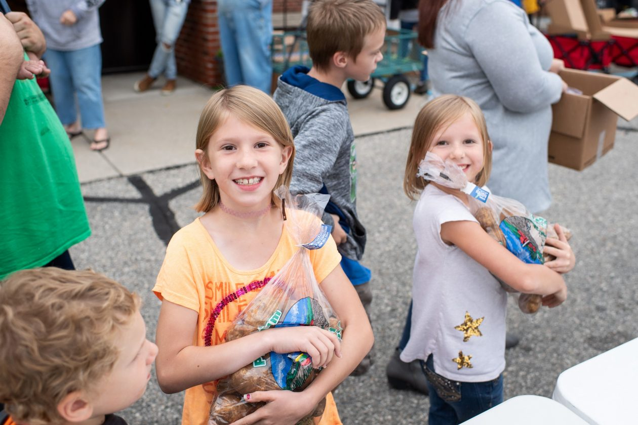 Little girls receive food at a Mobile Food Pantry.
