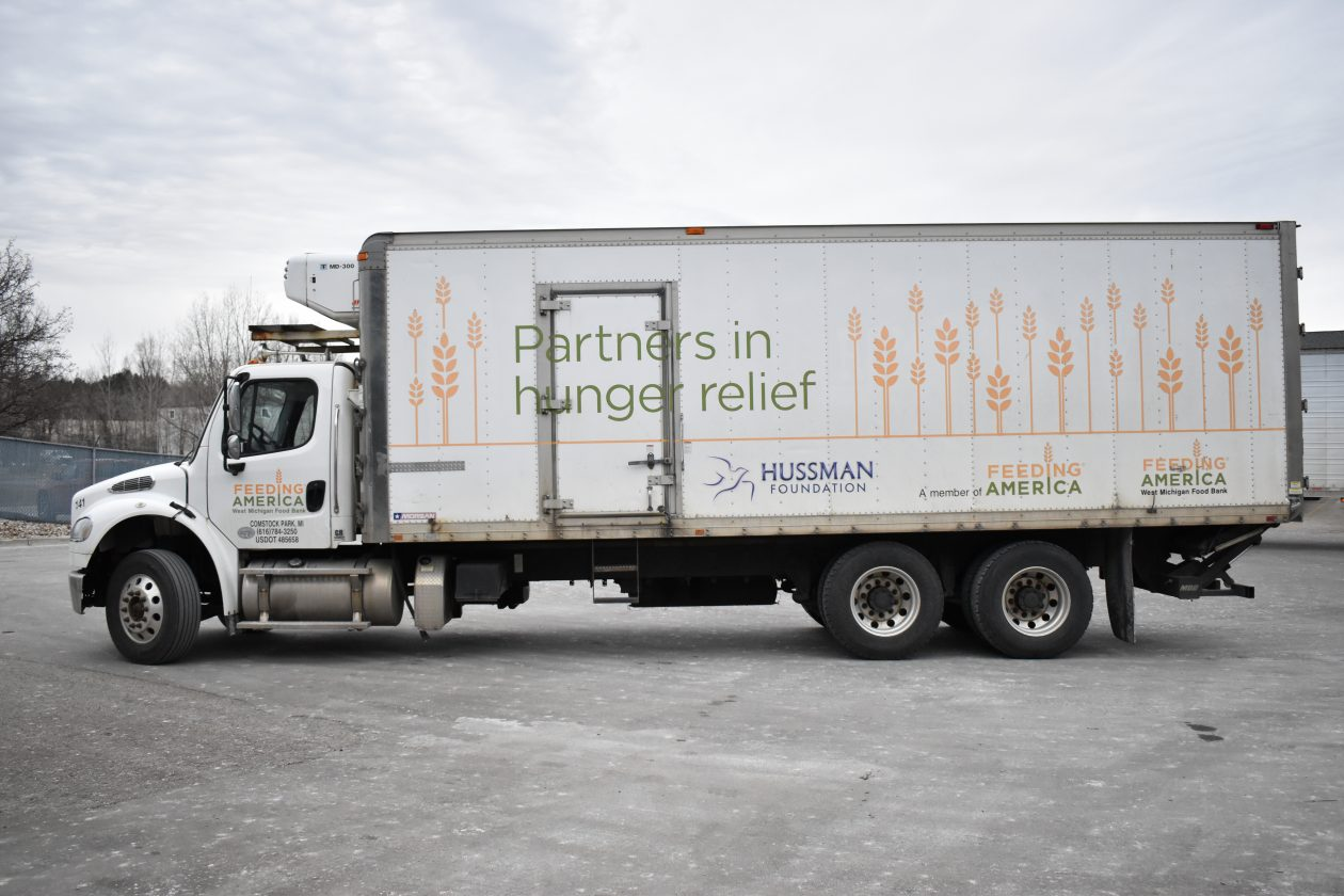 "A large truck reads ""Partners in Hunger Relief."""