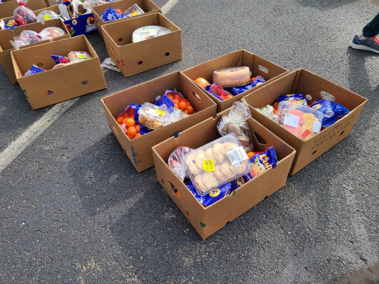 Food sits in boxes at a Mobile Pantry