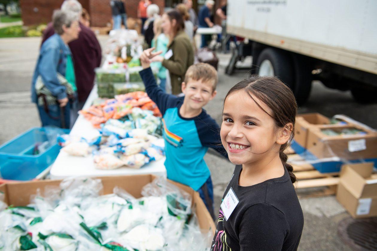 Kids volunteering at a Mobile Pantry