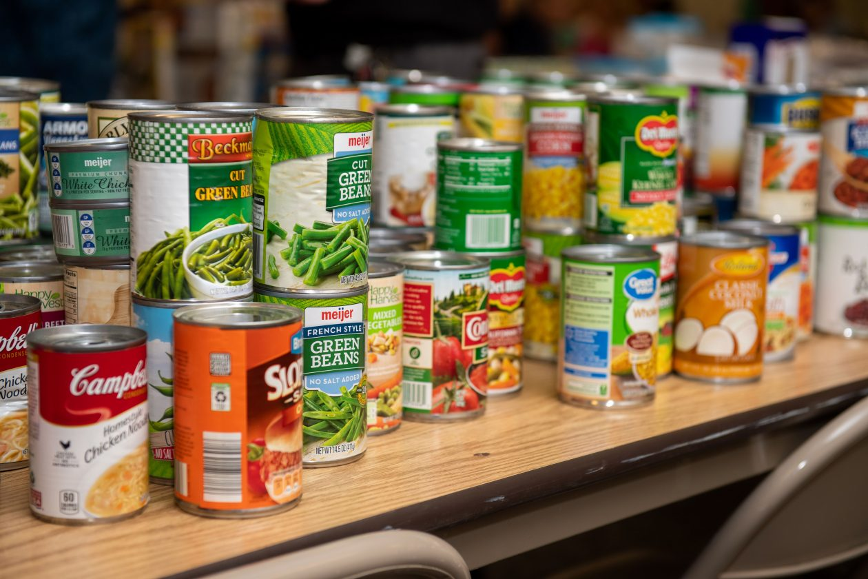 A bunch of canned goods sit on a table