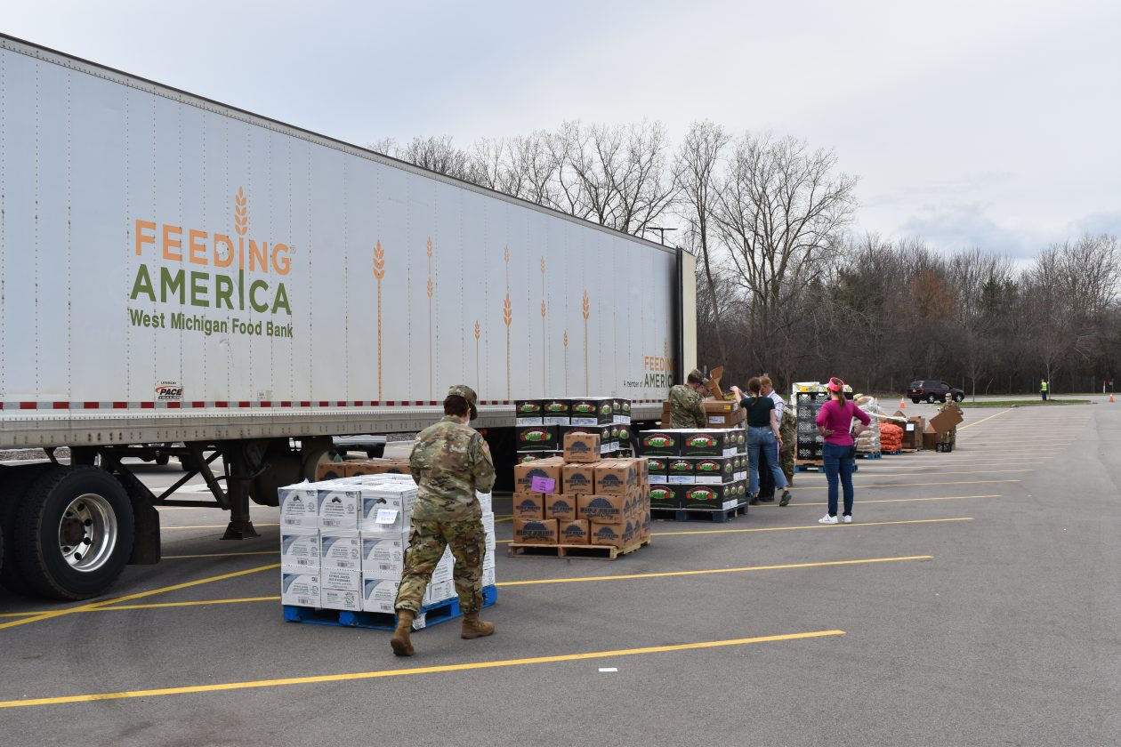 National Guard members help unload a truck for a Mobile Pantry
