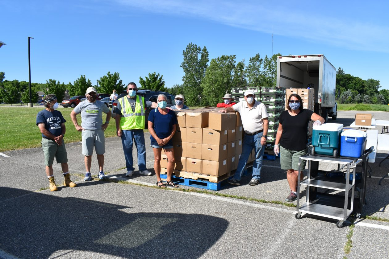 Volunteers wearing masks unload a Mobile Pantry truck.