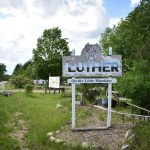 "Photo of sign reading: ""Luther: On the Little Manistee"""