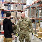 national guard helping in the warehouse