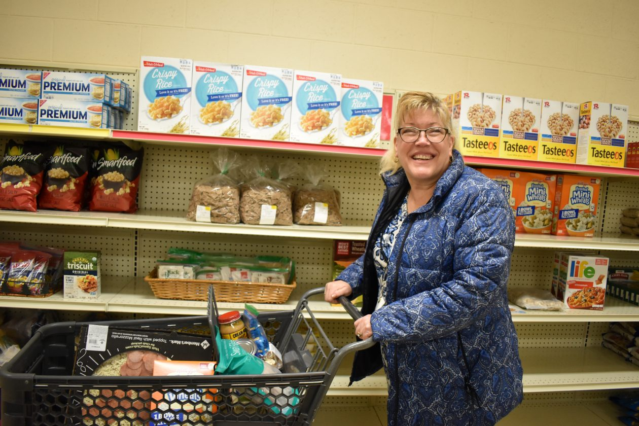 Deb shops for food at the pantry