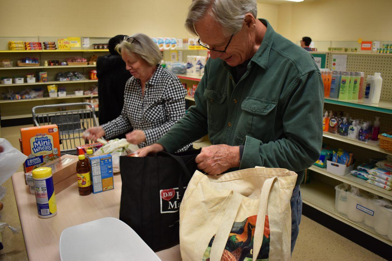 Volunteers bag groceries at the pantry