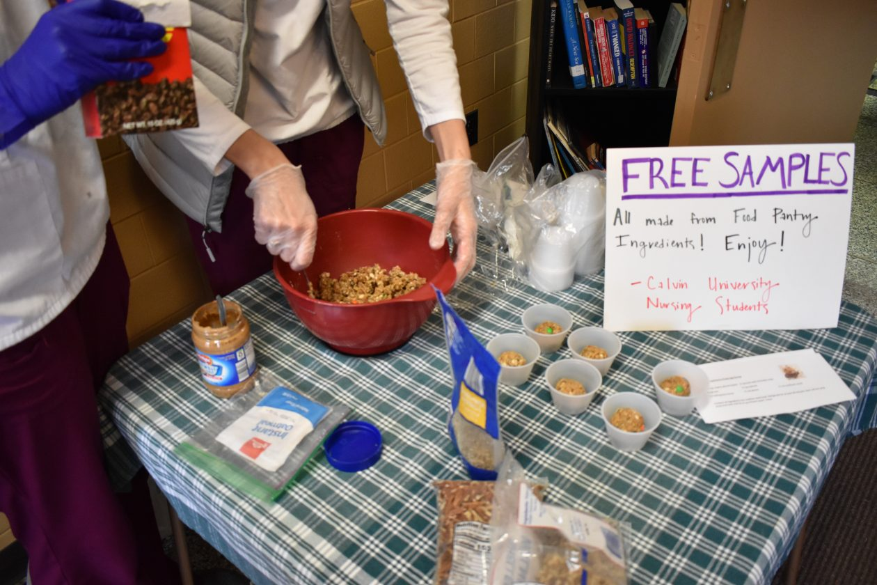 Nursing students demonstrate how to make energy balls