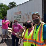 Mobile Pantry volunteers in front of truck