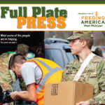national guard member carrying food to car on full plate press issue cover