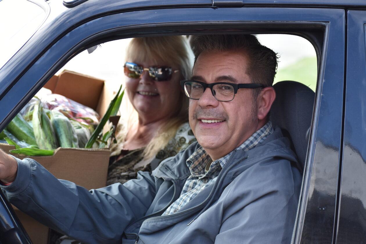 Tony and Terri pose in their car.
