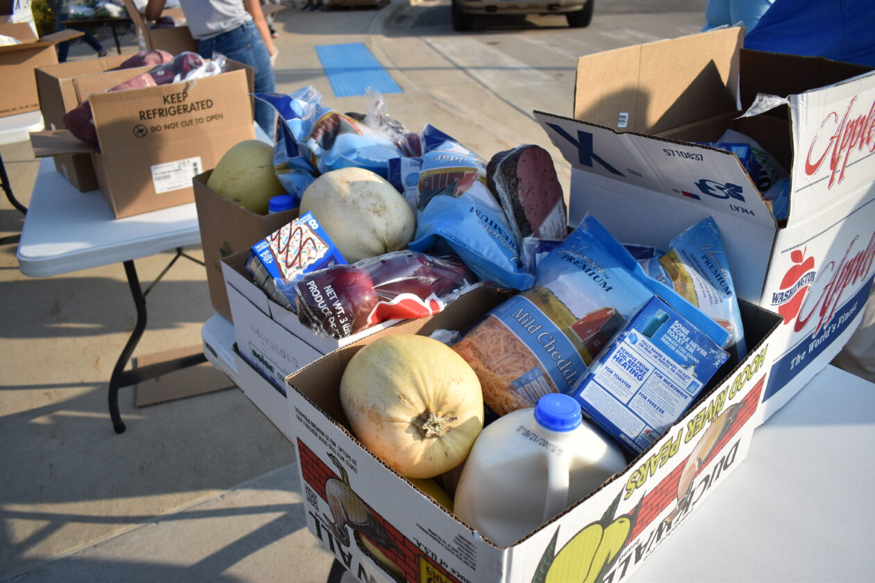 A box of mobile pantry food holds milk, squash, cheese, pop tarts and more