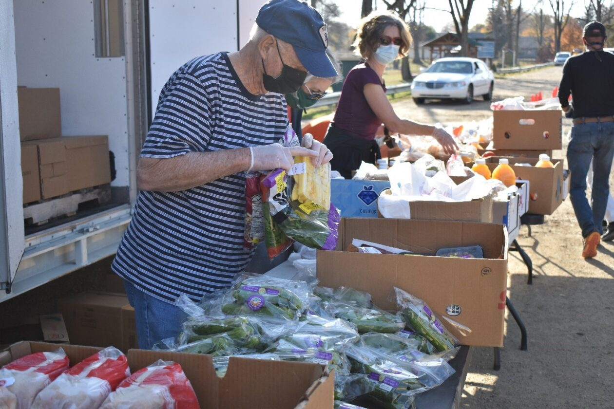 Volunteers fill boxes with food at a Mobile Pantry