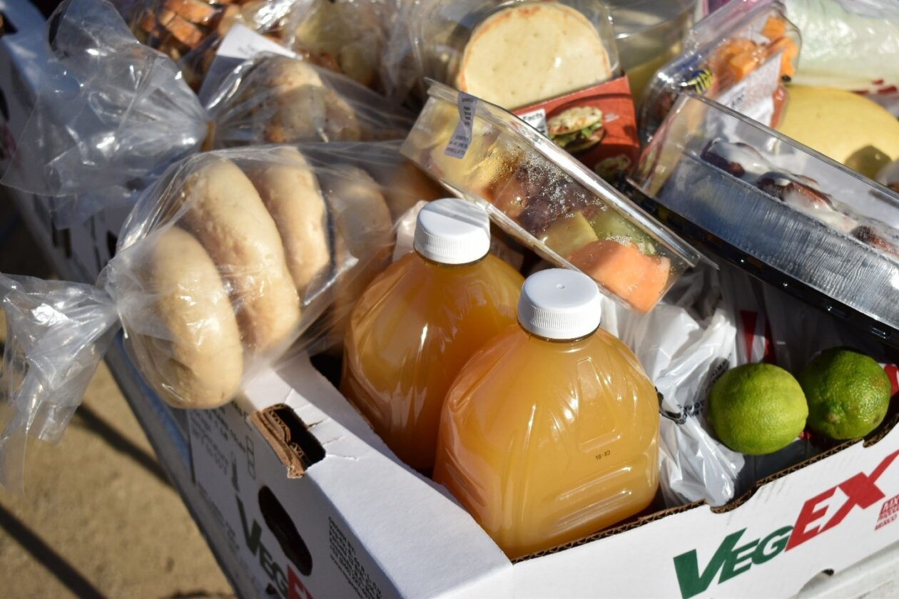 Box filled with food such as juice and bagels awaits distribution