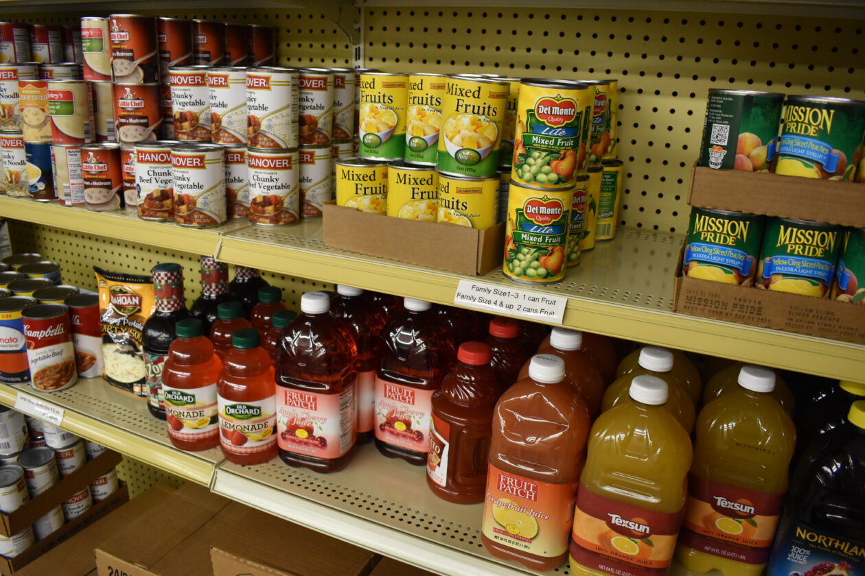 Juice, canned fruit and other shelf-stable foods sit on a shelf