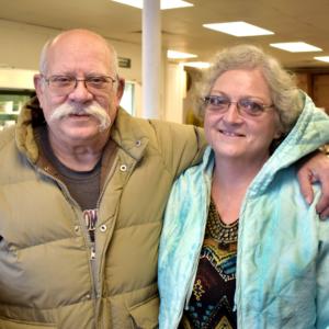 John and Lynn pose at the food pantry