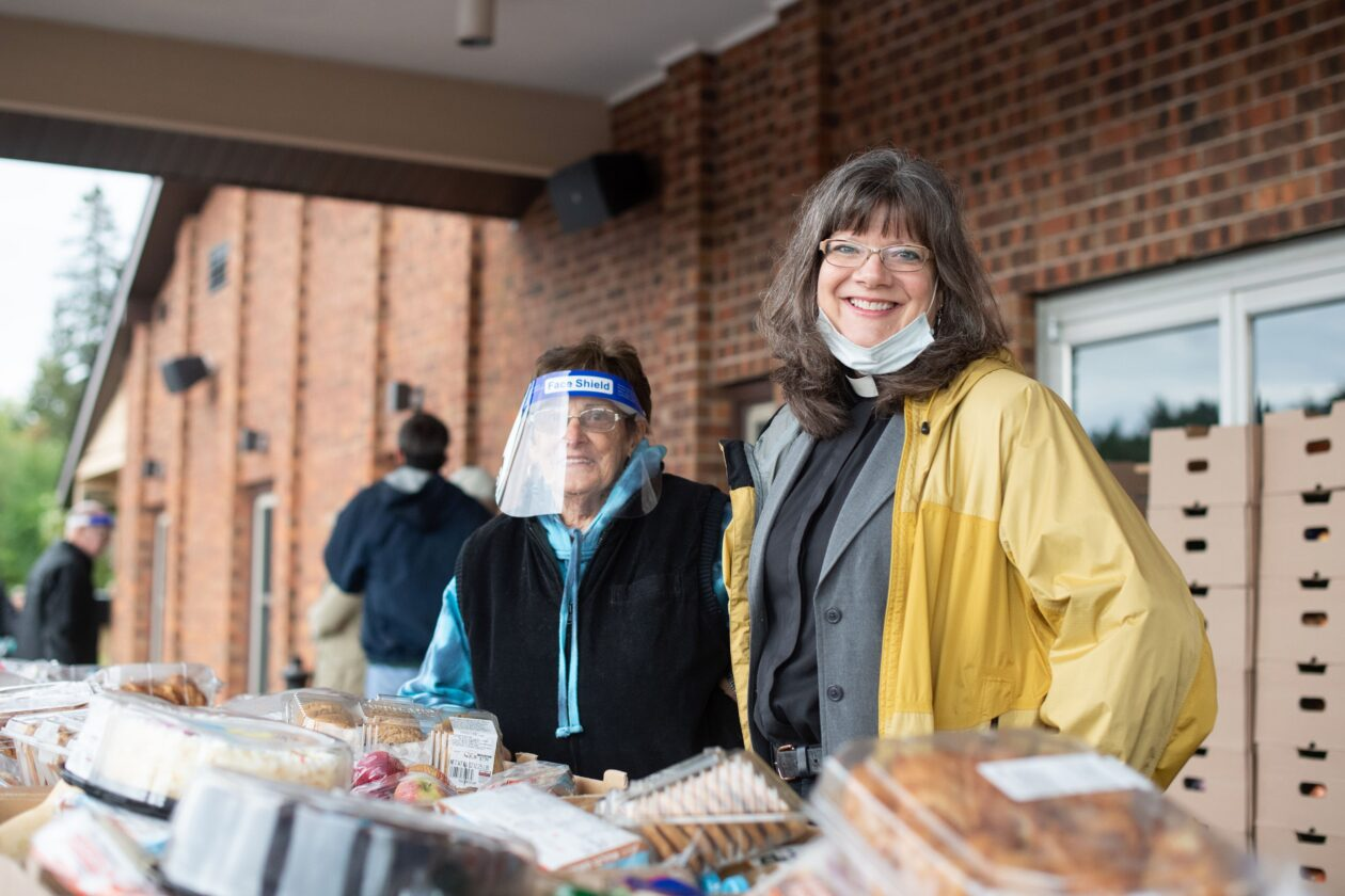Bishop Katherine and another volunteer