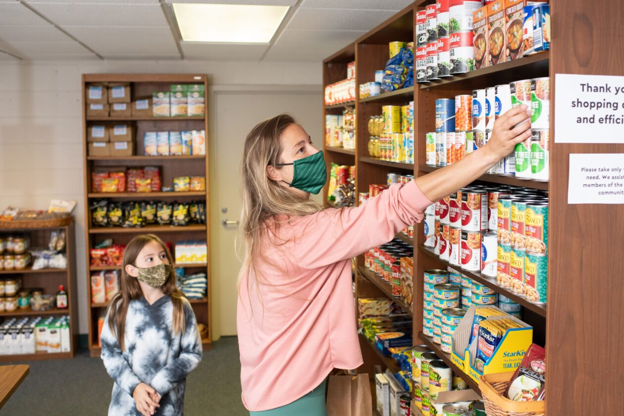 """Mary Ann and daughter """"shop"""" at a food pantry"""