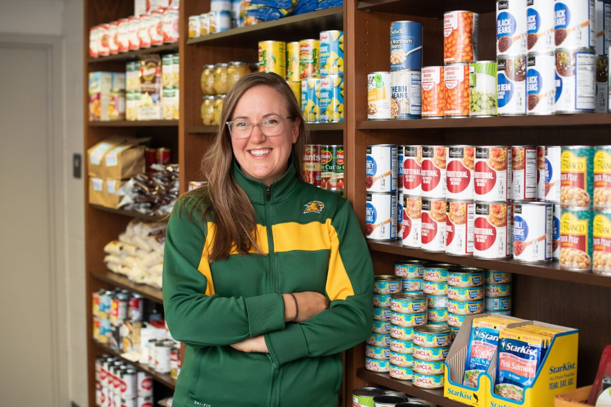 Haley standing by shelves of food