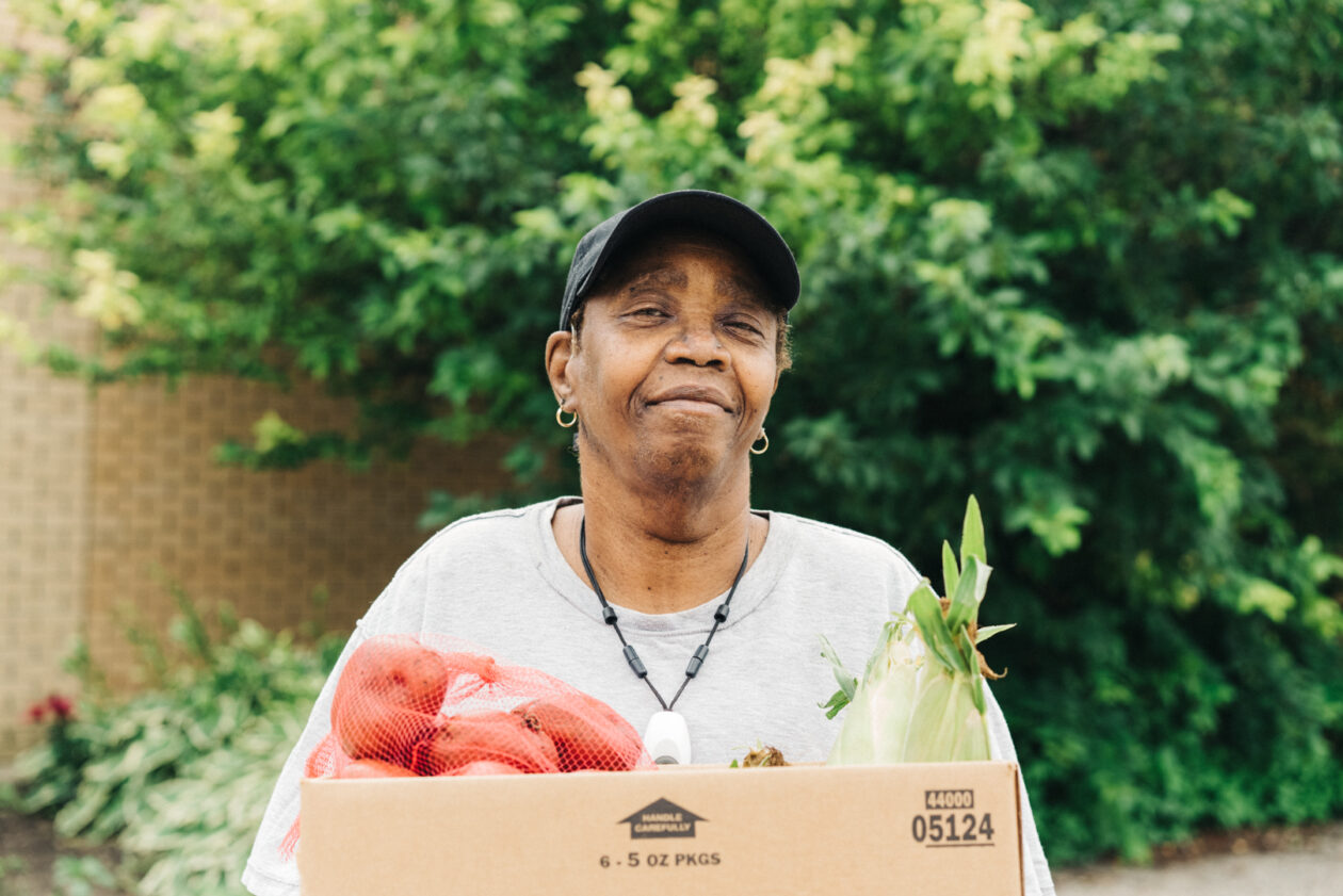 senior woman with box of food