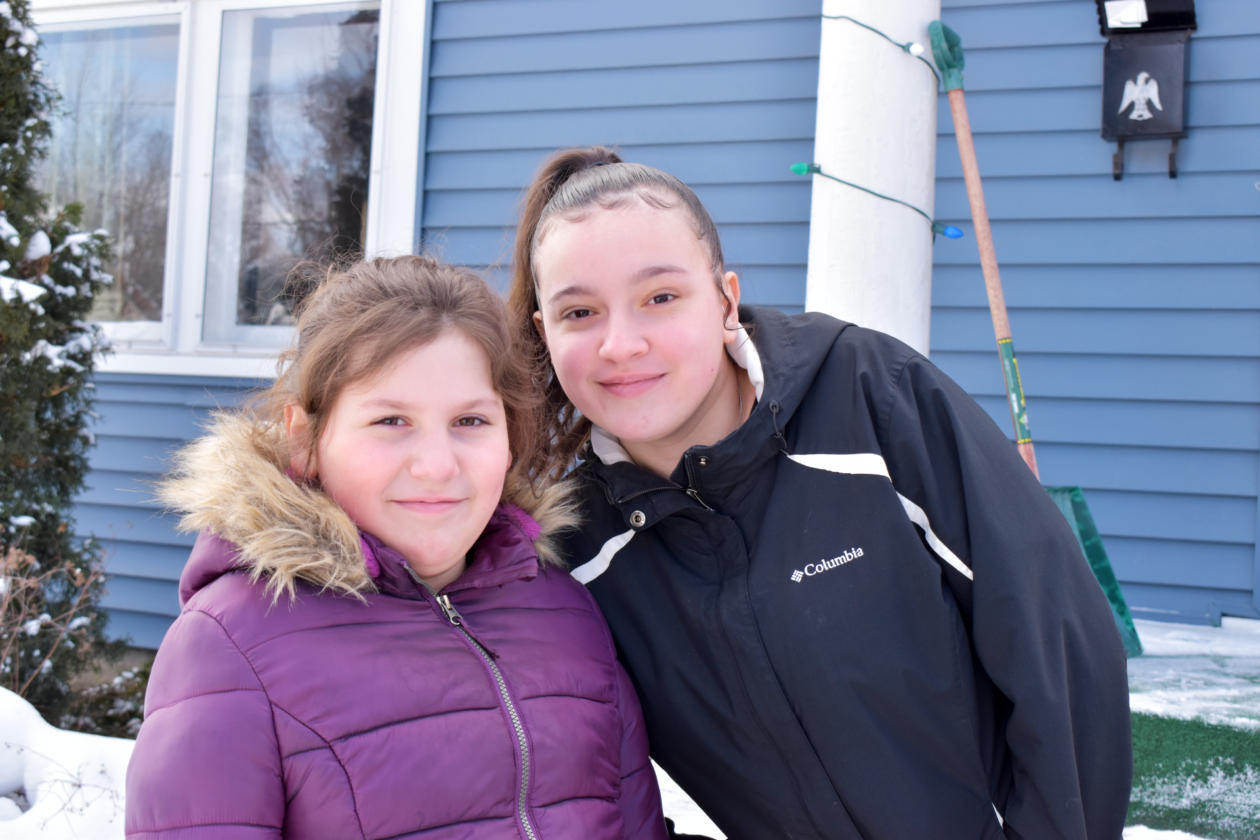 Lorena, 10, and her sister Lili, 15 pose for a photo.