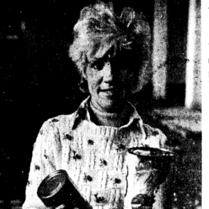Betty Alkema poses with some canned food. The photo is clearly from an old newspaper.