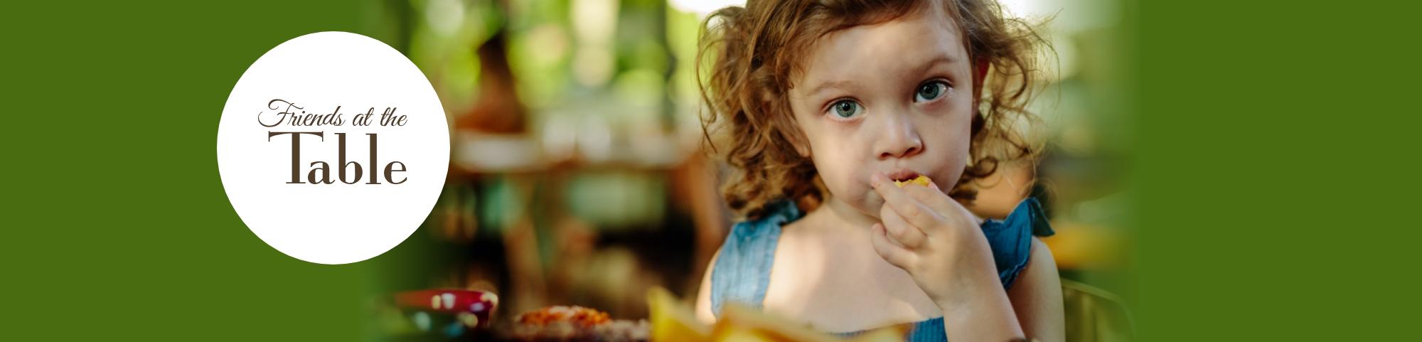 Little girl eating fruit
